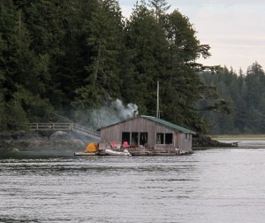 View of RainSong Studio floating in the harbor of Tofino in Clayoquot Sound BC